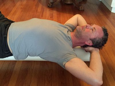 Bob lying supine on a foam roller